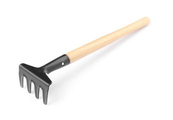 Metal rake for gardening on white background