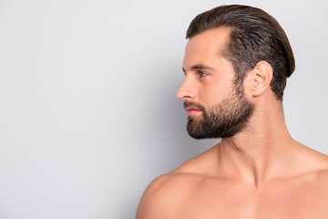 Profile side view half-faced portrait with copy space of handsome, muscular, athletic, confident, sporty, naked guy with perfect, ideal skin, isolated on gray background