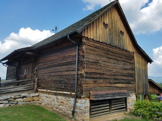 large old wooden barn with two hearts