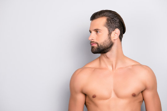 Profile side view half-faced portrait with copy space of handsome, sexy, athletic, confident, sporty, naked guy with perfect, ideal skin, isolated on gray background