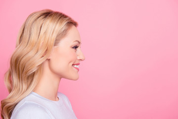 Profile side view portrait with copy space empty place for product of nice cheerful girl with modern hairdo isolated on pink background