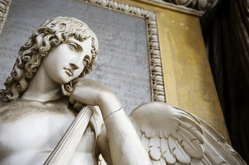 BOLOGNA, ITALY- DECEMBER 10,2017: Old statue of an angel inside the monumental cemetery of the Certosa di Bologna. The public cemetery was established in 1801.