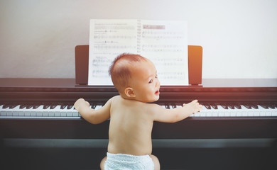 Little baby boy learn to play piano