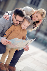 Happy family with map are ready to travel