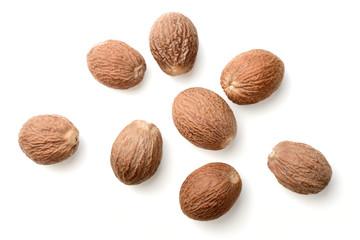 Fototapeta dried nutmeg isolated on white, top view obraz