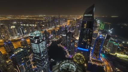 Fototapete - Night time lapse of modern Dubai marina downtown