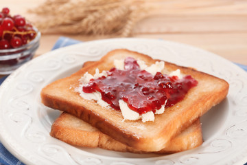 Tasty toasts with sweet jam on plate, closeup