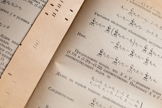 Yellowed page with mathematical formulas and calculations