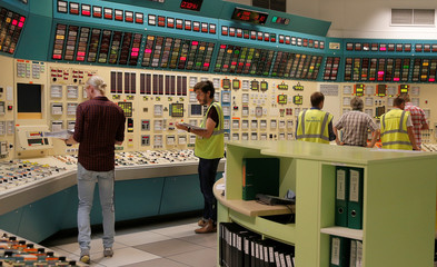 Employees of French state-owned electricity company Electricite de France (EDF) work in a simulated control room, during a nuclear accident drill at France's oldest nuclear power station in Fessenheim