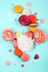 Composition of macarons and flowers