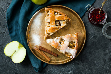 Plate with pieces of tasty homemade apple pie on table