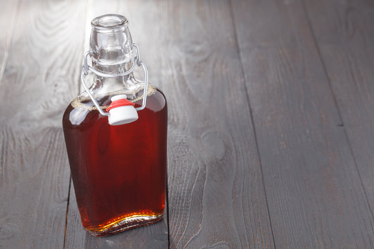 Homemade alcohol cordial drink in bottle on table