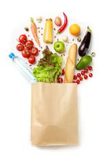 Image of paper bag with vegetables, juice, orange, loaf