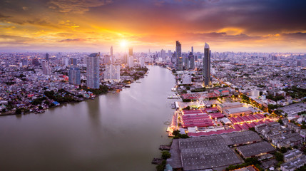 Wall Mural - Aerial view of Bangkok skyline panorama and skyscraper in center of Bangkok city. Modern buildings condominium at Chao Phraya River Bangkok Thailand at sunrise.