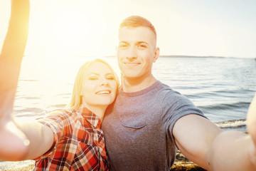 couple makes selfie beach