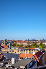 beautiful cityscape with old and modern buildings at sunny day in copenhagen, denmark