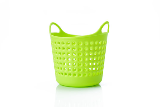 Green plastic basket isolated on white background