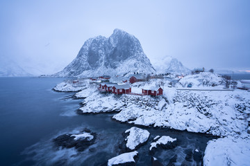 Hamnoy village after heavy snow at night all the red houses are covered with snow with haze scene / Landscape Photography