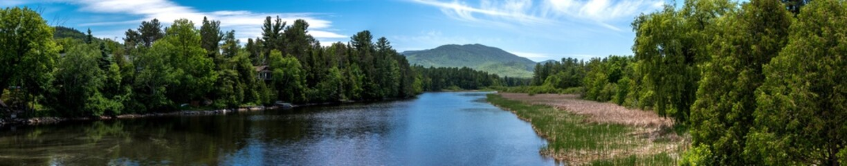 Panoramic view of a summer scene with river near Lake Placid