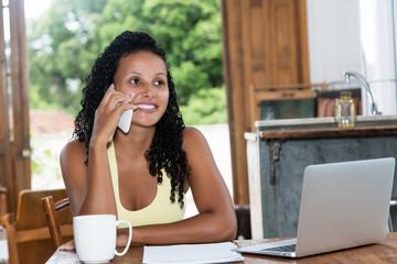 Beautiful latin american woman with black hair at phone