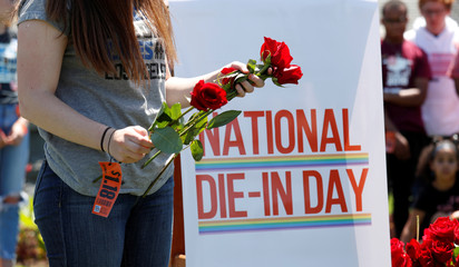Activists mark the second anniversary of the Pulse Nightclub shooting in Washington