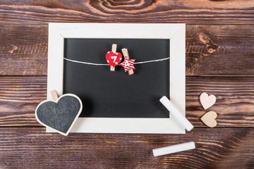Hearts, love, Valentine's Day on a dark wooden rustic background