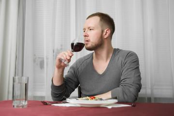 Man drinks wine