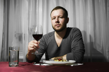 Man holding a glass of wine