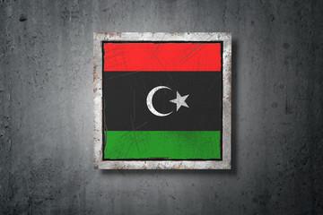 Libya flag in concrete wall
