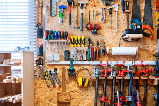 Workshop of wood with a large amount of instruments and tools.