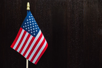 American Flag on Dark Wood Table