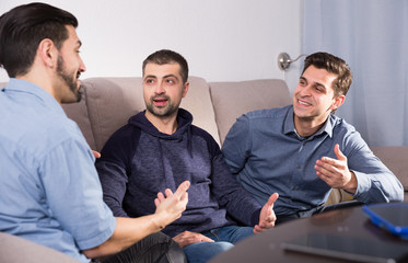 Friends enjoying сonversation on sofa
