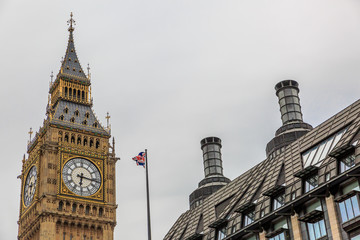 High part of the Big Ben Clock Tower in a cloudy day. London, England