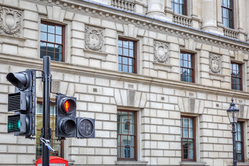 Traffic light in a typical street of London.