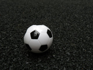 Football ball at the stadium with a black soft rubber coating