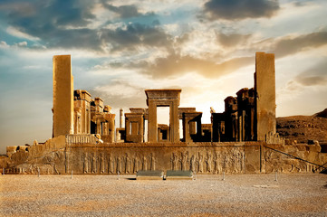 Sunrise in Persepolis, capital of the ancient Achaemenid kingdom. Ancient columns. Sight of Iran. Ancient Persia. Beautiful sunrise background. Wall mural