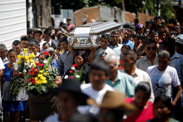 People carry the coffin of 17-year-old Aura Yolanda Perez Paz, who died during the eruption of the Fuego volcano, at her funeral in Alotenango