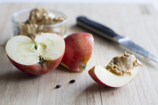 Slice of apple with peanut butter, a healthy snack