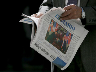 The front page of El Diario newspaper shows a picture of U.S. President Donald Trump and North Korean leader Kim Jong Un's Singapore summit, in La Paz