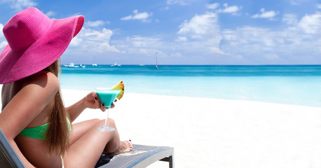 Luxury vacation for woman. White tropical beach