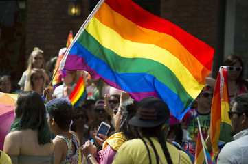 Participants wave rainbow flag and celebrate in the annual Pride Parade as it passes through Greenwich Village.