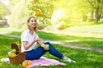 Young woman in park outside at sunny day