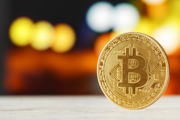 The golden bitcoin on marble table and bokeh background, golden bitcoin symbol of bitcoin crytocurrency from blockchain technology.
