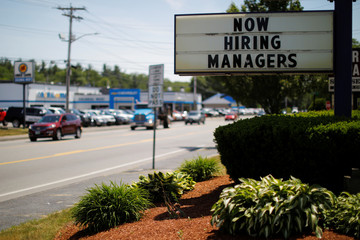 """The sign on a Taco Bell restaurant advertises """"Now Hiring Managers"""" in Fitchburg"""