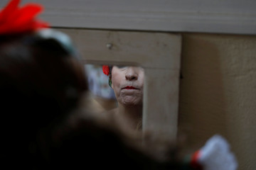 A member of Alfama's group gets ready before going to the Saint Anthony's Parade in Lisbon
