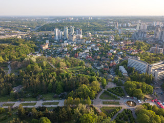 A bird's eye view, panoramic view from the drone to the view of the central alley of the Botanical Garden and the construction of the Pechersk district in the city of Kiev, Ukraine