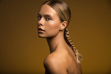 Woman with braid looking at camera