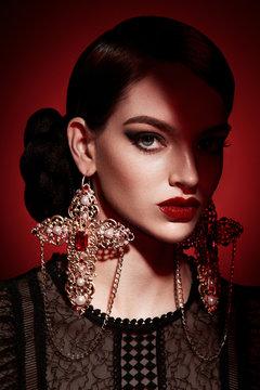Woman in ornate earrings