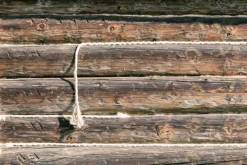 Weathered old wooden surface, texture with ropes, old wooden plank for grunge design, patterns, background, copy space