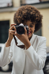 Female Photographer Holding an Old Analog Camera